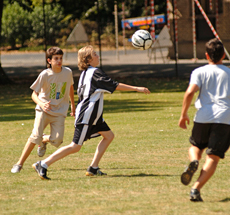 Students playing football during summer English course